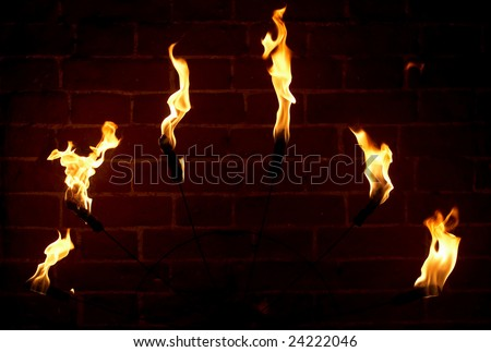 brick wall of a medieval castle and torch