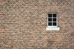 brick wall of old castle with window