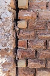 Brick wall of old house in disrepair