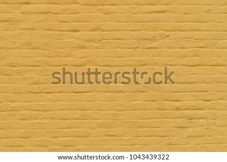 brick wall painted yellow texture