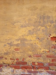 Brick wall pattern. Old wall built from the red bricks with remnants of plaster