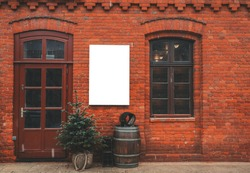 Brick wall restaurant facade with window, entrance, christmas decor and blank space for menu poster.