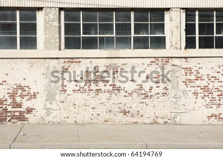brick wall sidewalk windows