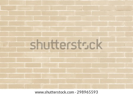 Brick wall texture pattern background in natural light ancient cream beige yellow brown color tone: Masonry brick work wall detail textured backdrop