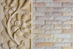 Brick wall texture with flower carving decorated, brick surface for background. Vintage wallpaper.