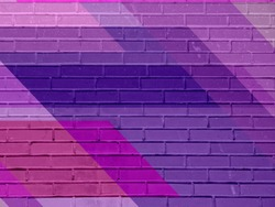 Brick wall texture with paint painted stylish street art design. Abstract multicolor urban graffiti.
