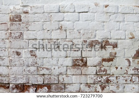 Brick wall white with traces of red brick