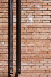 brick wall with a drain pipe
