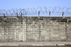 brick wall with barbed-wire