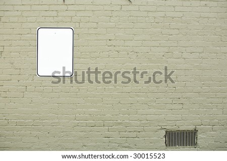brick wall with blank sign