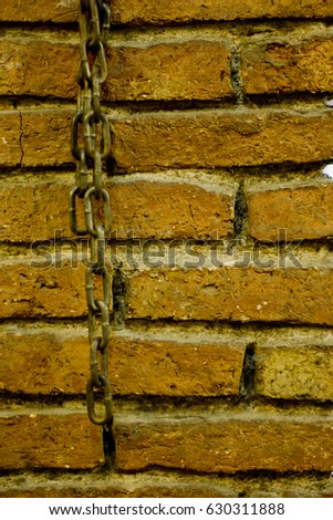 Brick wall with chain.