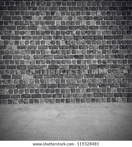 Brick wall with concrete floor background