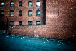 Brick wall with empty parking spots