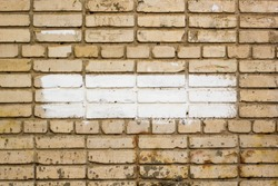 brick wall with painted splotch for your text and paper scraps as background or texture.
