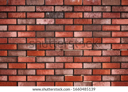 Photo of  Brick wall with red brick, red brick background.