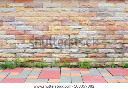 brick wall with sidewalk