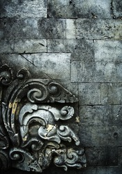 brick wall with stone carving