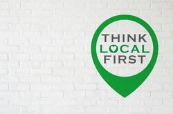 Brick wall with THINK LOCAL FIRST