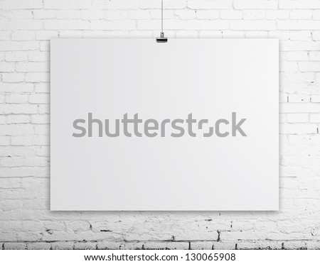 brick wall with white poster