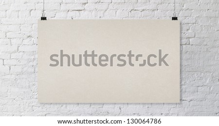 brick wall with yellow poster