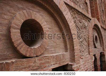 Brick walls with circles.  Shot at Montserrat in Spain.