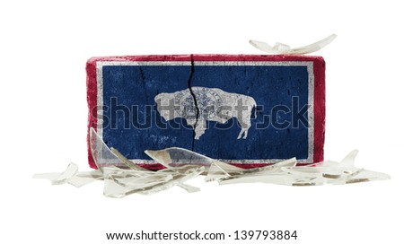 Brick with broken glass, violence concept, flag of Wyoming