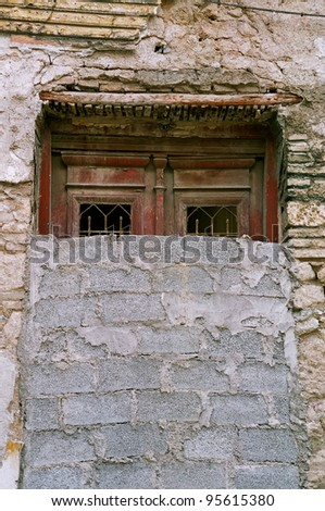 Bricked up vintage door and grungy wall. Abandoned house exterior.