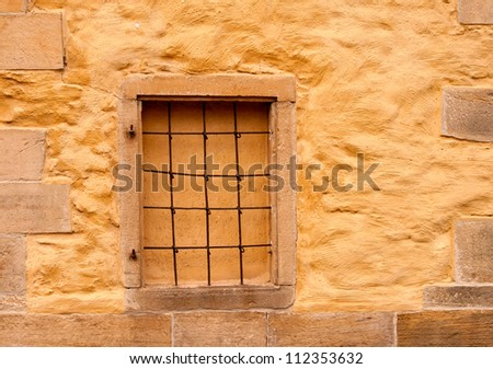 Bricked-up window in the wall of an ancient church