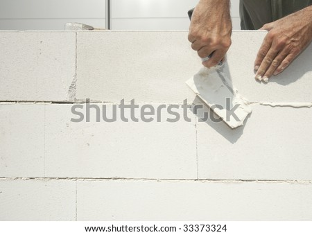 Bricklayer completing the wall