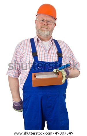 Bricklayer with hardhat in blue overalls holding bricks and trowel - isolated on white