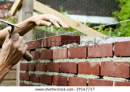 Bricklayer with trowel in hand