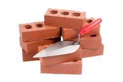 Bricks and a mason's trowel on a white background
