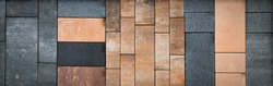 Bricks in different materials and colors stacked into a wall. Usable as background for architecture, building materials. Horizontal banner