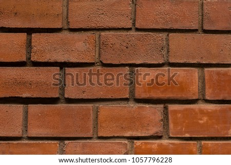 brickwork brown rectangular block close-up row of symmetrical horizontal vertical stripes gray cement lines endless urban pattern