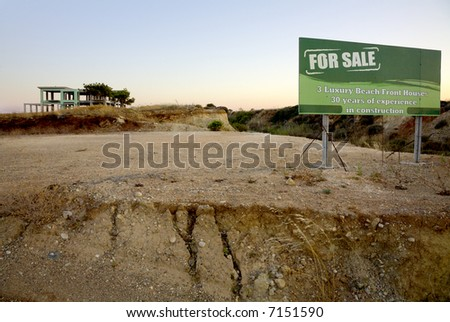 Brickwork of holiday home complex with a green advertising-sign in front of it (\
