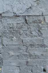 Brickwork wall stained with cement. Rough bricklaying texture. Destroyed brickwork.