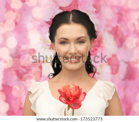 bridal and beauty concept - young and beautiful woman with flower