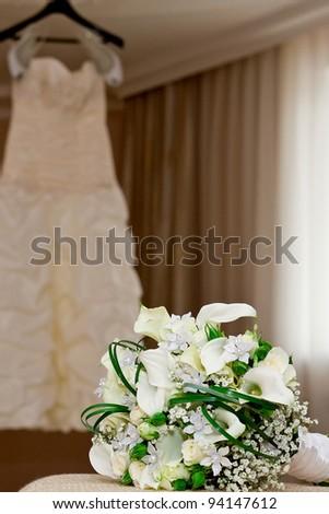 bridal bouquet and bridesmaid dress