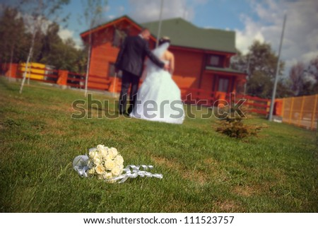 Bridal bouquet and the couple walking