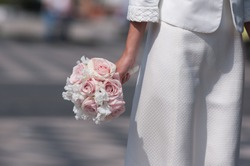 Bridal bouquet hold by bride focus on the flowers.