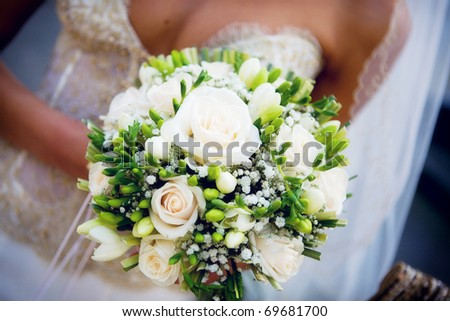 Bridal bouquet in the hands of the bride - stock photo