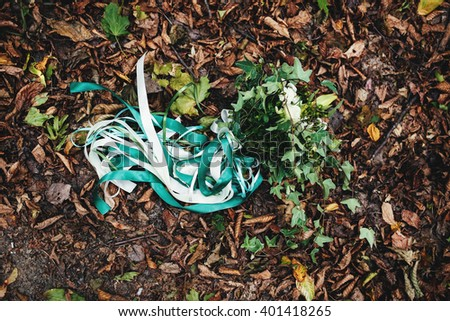 Bridal bouquet is lying on the dry leaves #401418265