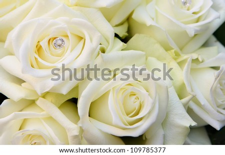 Bridal bouquet made of beautiful white roses with diamonds.