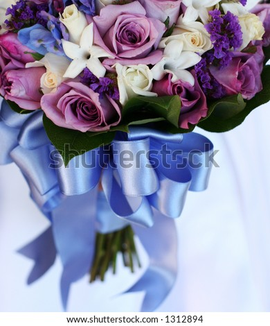 stock photo bridal bouquet of blue and purple flowers with a blue ribbon