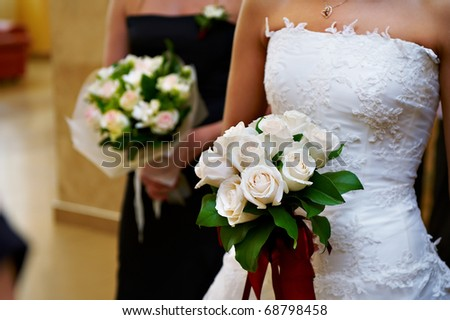 Bridal bouquet of flowers in her hand the bride and bridegroom in the mirror