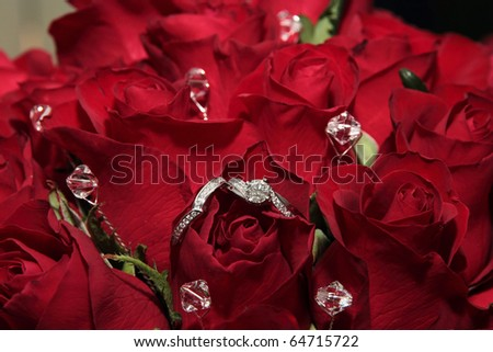 stock photo Bridal bouquet of red roses with platinum wedding rings