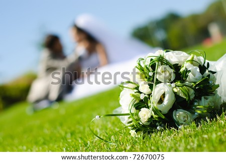 stock photo bridal bouquet of white roses on a green meadow and blurred