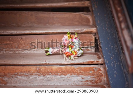 Bridal bouquet on wood stairs