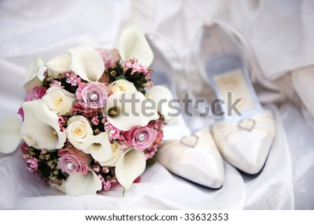 bridal bouquet posy with wedding shoes. very nice decoration before the zenith