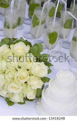 stock photo bridal bouquet with cake and champagne on white table